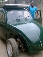 Segun Oyeyiola and His Green Car