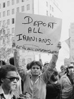 Man Holding Sign: Deport All Iranians