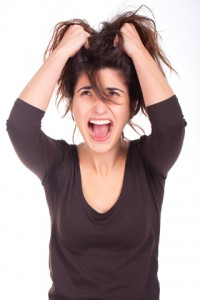 http://www.dreamstime.com/stock-photo-woman-pulling-her-hair-screaming-image29010810